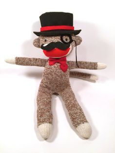 This Gentleman Sock Monkey is made with love and has a red heart stitched on. It is handmade from a new pair of medium Rockford Red Heel Socks,
