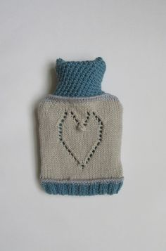 A hand knitted colour block hot water bottle cover with a panel of lace work on the front. The back envelope style opening is edged in a teal coloured lacy stitch, which is the carried on up over the neck of the cover. Colour Block, Color Blocking, Water Bottle Covers, Lace Heart, Teal Colors, Yarn Colors, Crochet Hats, Knit Crochet, Hand Knitting