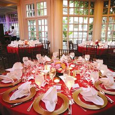"Rich red tablecloths, gold chargers and white napkins. The reception was held at the Fairmont's Colonnade restaurant. ""I loved that the space felt like a greenhouse, with wall-to-wall windows and a glass roof,"" says Stacy."