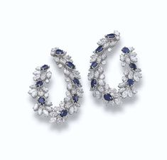 A PAIR OF DIAMOND AND SAPPHIRE EAR HOOPS, BY HARRY WINSTON   Each designed as a series of flexible, marquise-cut diamond and pear-shaped sapphire clusters, 5.0 cm long  With maker's mark of Jacques Timey for Harry Winston