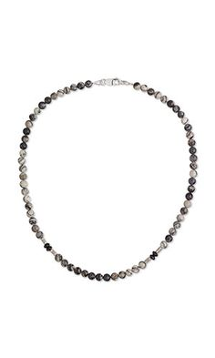 DIY Jewelry Project: Black onyx and fine silver beads create this unisex necklace. It is easy to wear and pairs well with collared shirts and T-shirts, and can be dressed up or down for a multitude of looks. String this gem of a necklace to celebrate dads and make them feel special throughout the year. Add this piece to jewelry lines or used different gemstones to create a different look. - Fire Mountain Gems and Beads #diyjewelry #jewelryproject #diymensjewelry