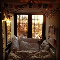 Autumnal room with the huge cozy bed, stringed lights, and warm vibes.