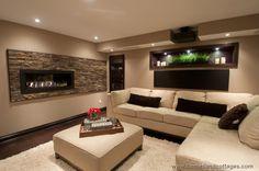 Modern Basement with Stone Fireplace