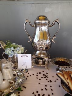Coffee station at wedding catered by Heirloom Cuisine. Love the coffee beans sprinkled on the table!!!
