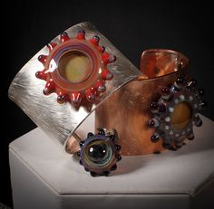 brushed copper & silver cuffs with original borosilicate glass cabachons! Stunning jewelry! Art for your wrist!
