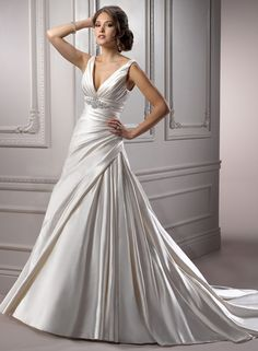 Maude - by Maggie Sottero - not what you had in mind - but gorgeous - always try on one dress you would never consider - :)