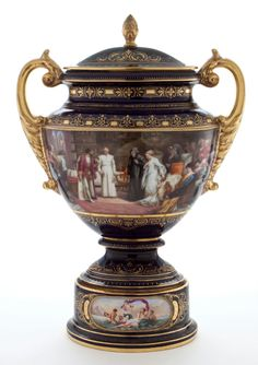 VIENNA STYLE PORCELAIN COVERED VASE ON STAND WITH SCENIC PANELS DEPICTING COLUMBUS BEFORE THE ROYAL COURT. Austria, late 19th c.