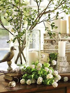 Give a natural feel to your living room with this décor idea. Add wooden furnishings to your coffee table as well as twigs and flowers for design, the use of organic embellishments and the like help make the décor look neat and clean.