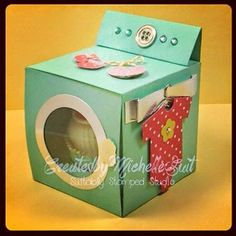 "A fun baby favor or gift...""Sock it to me, Baby"" is a ""dryer"" made out of card stock and it holds two pairs of baby socks. More info on my blog at disneysuitsme.blogspot.com Michelle Suit - Independent Stampin' Up! Demonstrator Shop: stampinsuitsme.stampinup.net Email: shellsuit@verizon.net"