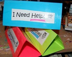 "3-tier paper tent. The sides say ""I need help,"" ""I'm working hard,"" and ""I'm finished."" This is good for kids to self monitor and will definitely help to alleviate all the ""I'm done, what do I do now!?"""