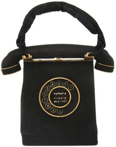 Leather or suede handbag, Annemarie of Paris France, from the late 1940s..The dial on this 'Telephone' Purse features the name and phone number of its owner.