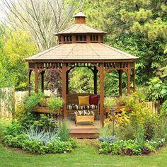 Pavillon de jardin en bois massif au mobilier en rotin