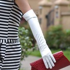 White Gloves 2 LEFT Attention fashionistas or brides to be! Beautiful full length white gloves. Add some pop to a stylish outfit or for that formal event you are attending. Brand new! I have many of these! They also come in black. 18 inches long and stretchy. One size fits most. JHats Accessories Gloves & Mittens