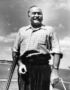Ernest Hemingway enjoys a visit, rifle in hand, at Club de Cazadores del Cerro, Rancho Boyeros, Cuba. Courtesy: John F. Kennedy Presidential Library and Museum Ernest Hemingway, Cuba, Julian Barnes, Titanic History, Story Writer, Writers And Poets, American Literature, Latest Generation, The New Yorker
