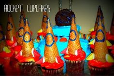 Rocket Ship Cupcake toppers made from sugar cones, frosting and candy #outerspace #rocket #party