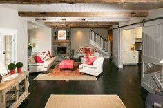"""GREAT touches. Love the barn doors, flooring, wood """"beams"""", wainscotting, pops of color on neutral furniture...good job!!"""
