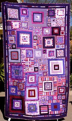 purple quilt.  I want to do more quilts like this, scrappy but with a design