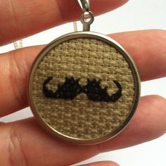 Items similar to Gentleman's Black Moustache Cross Stitch Necklace in Brown and Silver on Etsy