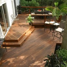 This shaded deck has a main area for dining featuring a curved front. Stepping down there is plenty room for entertainment