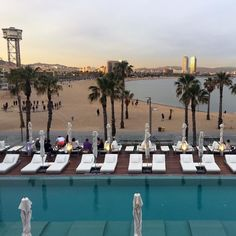 Sunset  over the #WHotelBarcelona pool and Sant Sebastià Beach. What I wouldnt give to be relaxing here with a cocktail or two.   This photo is taken from the sun terrace of the #WBarcelona. It is one of my favourite hotels in Barcelona. You can read my review and see why. Review can be found on www.melaniemay.com. #hotel #hotelview #poolside #sunset #sunseasand #spain #barcelona #luxuryhotel #fivestarhotel #hotelpool #luxlife #travelblogger #travelblog #hotelreview #whotels #barcelonabeach…