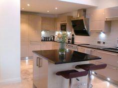 Contemporary high gloss mocha kitchen with Star Galaxy Granite worktops.