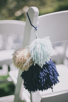 yarn poms for ceremony chairs, photo by Edyta Szyszlo http://ruffledblog.com/allied-arts-guild-wedding #weddingideas #ceremony