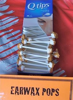earwax pops - mini marshmallows and melted butterscotch chips.  Deliciously disgusting. Halloween or Harry Potter Birthday