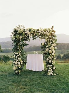 White rose and green vine outdoor wedding altar at Pippin Hill Farm & Vineyards | Photographer: Laura Gordon