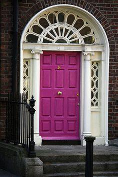I love old doorways, but a hot pink door is straight up fun