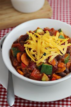 This Veggie Chili recipe is loaded with healthy vegetables and fiber-rich beans – it's great for any occasion from game day to a family dinner. #vegetarian