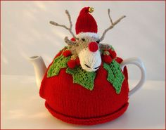 Rudolph Reindeer has his very own Christmas Tea Cosy. He has decorated it with holly leaves bearing red and gold berries. To complete his festive celebrations he has knitted himself a Santa hat complete with jingle bell on top! This cheery handknitted . Tea Cosy Knitting Pattern, Tea Cosy Pattern, Knitting Patterns, Rudolph Christmas, Christmas Tea, Christmas Crafts, Holiday, Knitted Tea Cosies, Knitted Bunnies