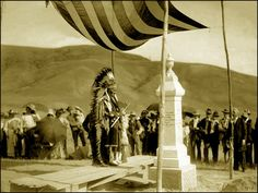 Nez Perce man Yellow Bull at Chief Joseph's tombstone, Colville Indian Reservation, Washington. Chief Joseph died in 1904. Photographed by Edward S. Curtis, 1905.