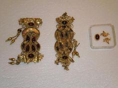 The Fitzwilliam Museum :  Belt Ornament Material(s): Gold, garnets, glass Date of Object: 3rd century BC Origin: Greek Measurements(s): L: 7.7cm; W: 3cm; Weight: 31.283g Provenance: The Georgian National Museum Find Location: Vani: