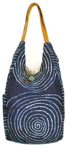 This indigo-dyed reversible hemp tote bag is versatile and stylish. Made by artisans in Laos. $125.00 @Clothroads.com