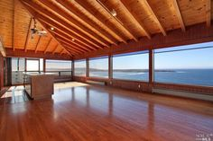 Beautiful room with exposed ceilings, overlooking a beach in Northern California.