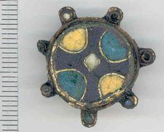 Label: Late Saxon Cloisonné enamel disc brooch. Broadperiod: EARLY MEDIEVAL County: NORFOLK