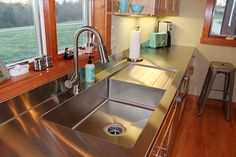 Custom drainboard sink and stainless steel countertop - all one piece. Love.