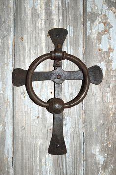 Wrought iron cross door knocker
