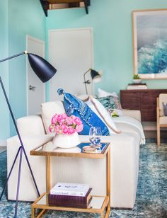 """The deep-blue rug was a favorite of both Whitney and Orlando. The designer says he picked it because its vibrant hue referenced the nearby ocean while its plush texture softened up the concrete floors. """"The rug makes it really homey and has a traditional aspect to it which we love,"""" summarizes Whitney."""