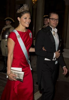 Looking stunning in scarlet red, Crown Princess Victoria and husband Prince Daniel of Sweden .  Victoria is wearing the unusual, but extremely lovely, cut steel tiara on her state visit to Portugal.  10/1/2013
