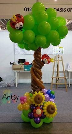 Lovely summer themed balloon column tree.