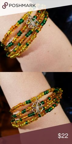 🍀For my Irish girls!🍀 🍀My signature wrap bracelet that can also be worn as a necklace. PERFECT CHOKER!  Stunning green, orange and Gold sterling silver lined, to make them shine brighter glass beads. Strung on thick stretch cord for durability with an adorable 4 leaf clover charm. Handmade by me 🍀 Magen's Fairytale Creations  Jewelry Bracelets