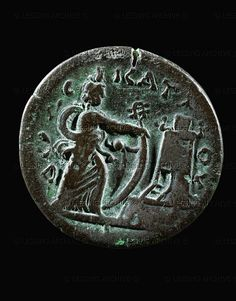 Isis holding sail and sistrum; lighthouse of Pharos and Greek inscription on the verso of a bronze coin, mint of Alexandria, Egypt. Period of Roman Emperor Antoninus Pius (138-161 CE)    National Maritime Museum, Haifa, Israel