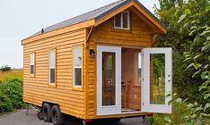 This 160 sq. ft.Cabin in the Woods Edition tiny house on wheels is built on a 20′ trailer designed and built byTiny Living Homes.