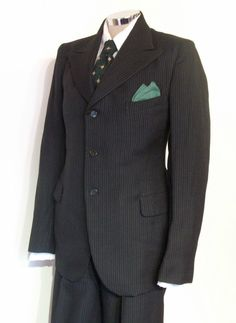 It is an original early to mid-1930s 3-piece suit in a coarse wool material of charcoal black, with broken white, grey and deep red pinstripes. The shape is sharper than a tack; very high-waisted, wide leg 'Oxford Bag' cuffed trousers, button-fly and fitted at the waist with smooth darts in the back and pairs of pleats in the front. | eBay!