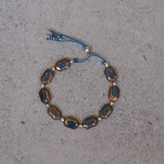 Blue Lagoon Bracelet / Turquoise Glass / Polygon Antique Silver / Metallic Silver, Blue Cord / Adjustable / Layering / Turquoise & Copper by saltrabbit on Etsy https://www.etsy.com/listing/236306900/blue-lagoon-bracelet-turquoise-glass