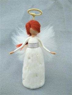 This is simple but very beautiful needle felted angel. She wears silver band around her waist and on skirt are white pearls and silver stars. An angel is available self standing or with wind chimes, for which I borrowed the pattern from my other items from group animal spirits. The