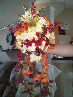 I created my own wedding bouquet using fake flowers I found at Michael's. I am doing this for all the flowers on my wedding, cost went from 6-800 for real down to less than 300! Highly recommend it :)