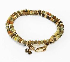 This green garnet and gold wrap bracelet has been designed with high quality faceted garnet gemstones and 14 kt gold filled beads. Garnet Bracelet, Garnet Jewelry, Garnet Gemstone, Gemstone Bracelets, Gemstone Jewelry, Unique Jewelry, Garnet And Gold, Brides And Bridesmaids, Yoga Inspiration