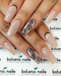 Fake nails might not really look that great without any design at all. That's why fake nails are usually accompanied by nail art materials to make it look better. In this example, nail art, think black crescent moon nails and gold rhinestones would make it a tad classier.